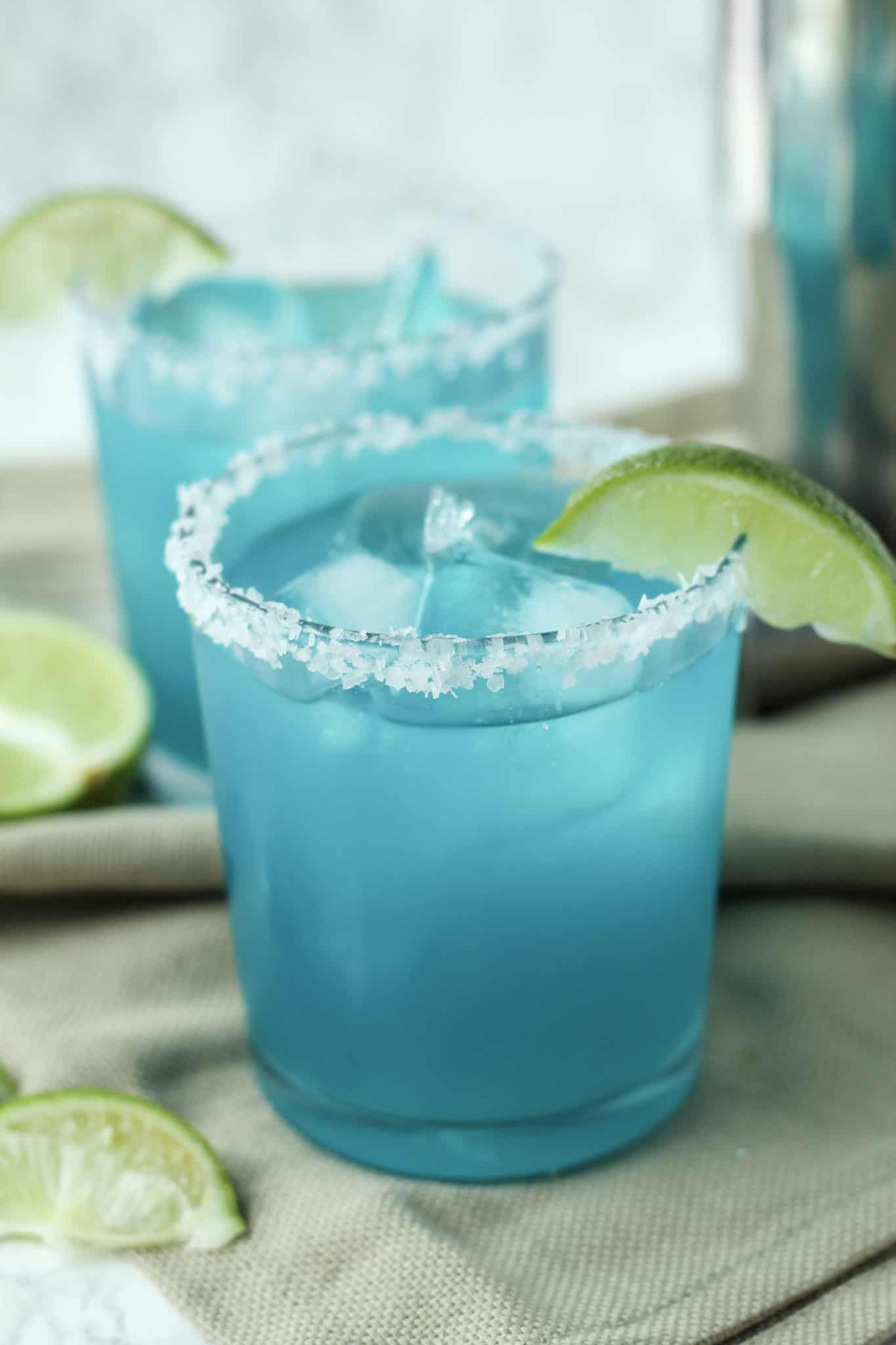 One Blue Margarita close up with a salted rim and lime slice