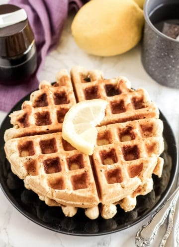 Waffle on a plate with lemon