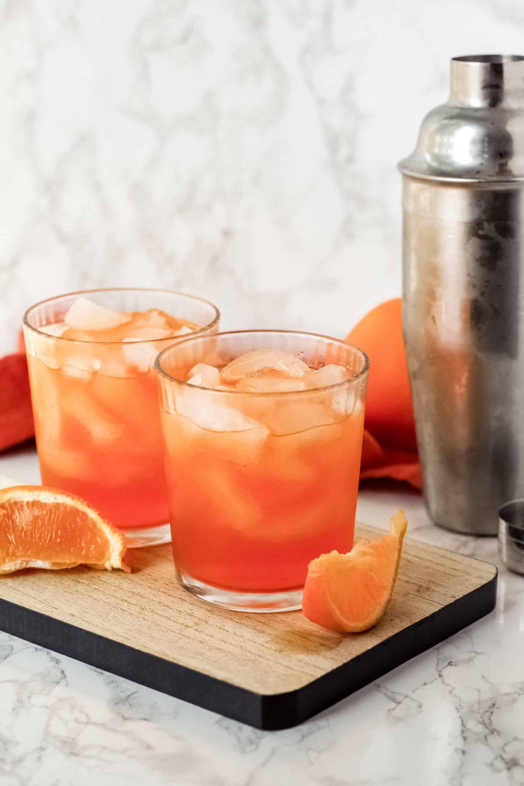 two orange thunders on a tray with orange slices