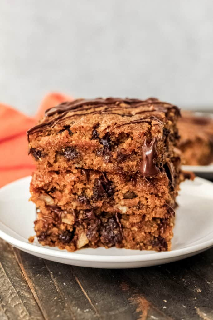 stack of three pumpkin bars on a plate