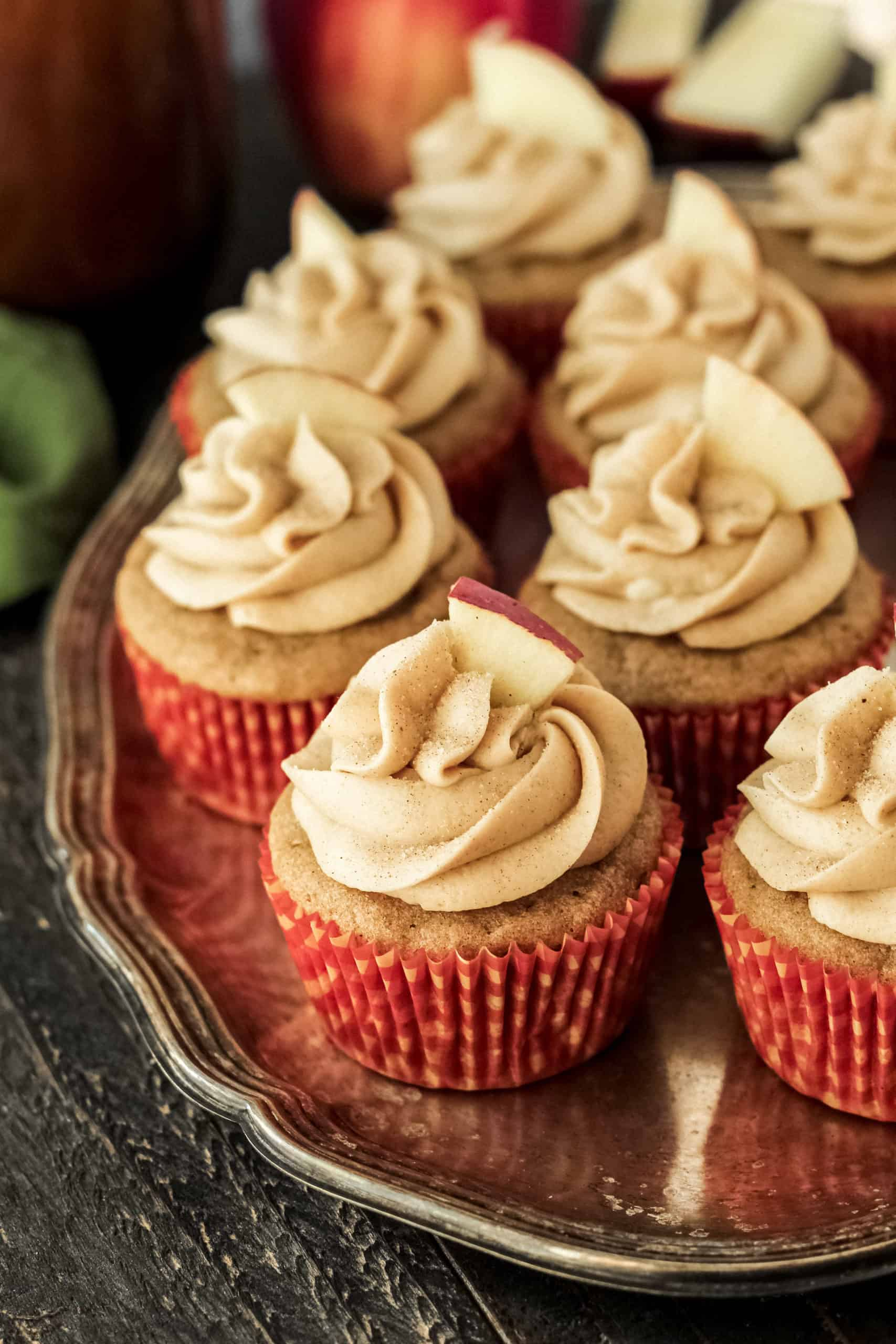 Apple cider cupcakes on a silver tray.