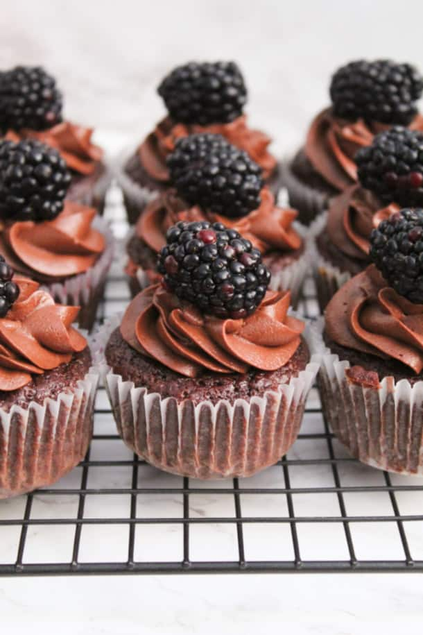 Three rows of chocolate red wine cupcakes on a wire rack