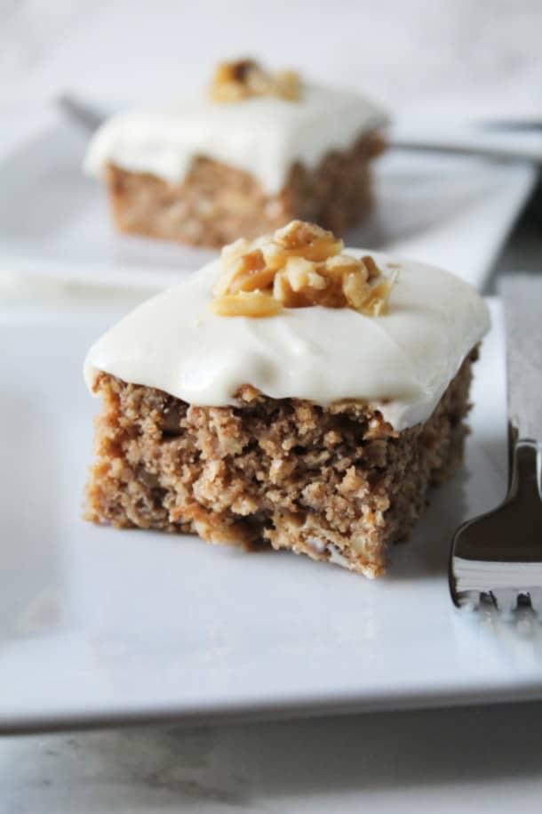 Two pieces of Spice Cake on two plates with forks