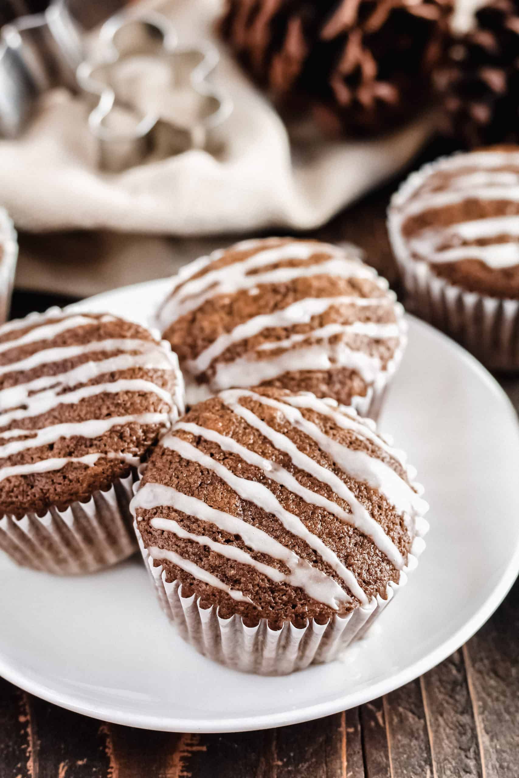 three gingerbread muffins on a plate