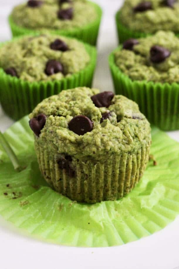 one Mint Chocolate Chip Oat Muffin up close with the green liner taken off