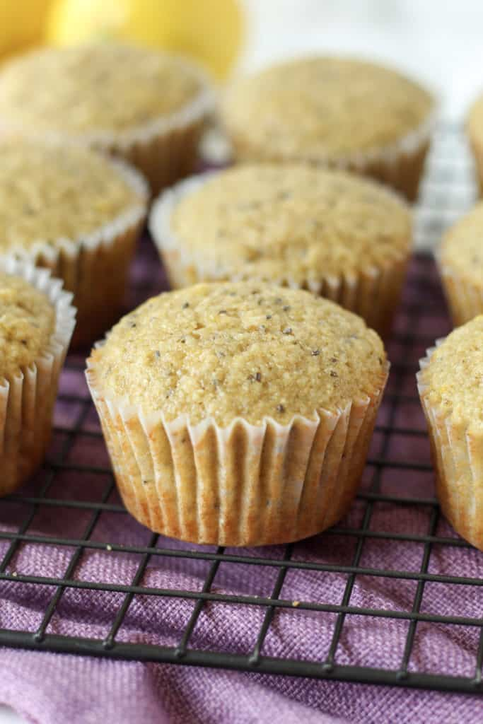 side view of Lemon Chia Oat Muffins on a cooling rack