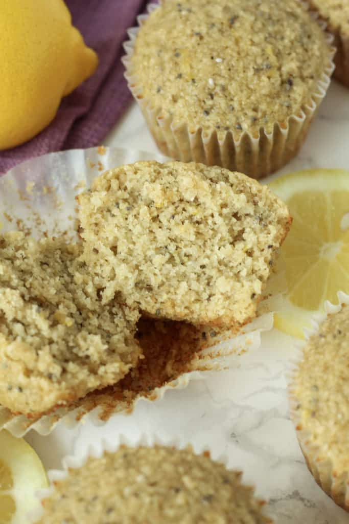 one Lemon Chia Oat Muffin cut in half and close up to see the inside