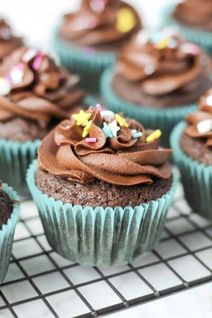 side view of one Chocolate Cupcake on a cooling rack