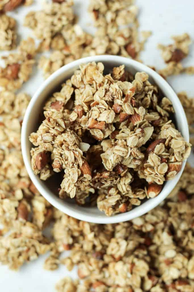 top down view of a bowl of Maple Nut Granola with more granola scattered around