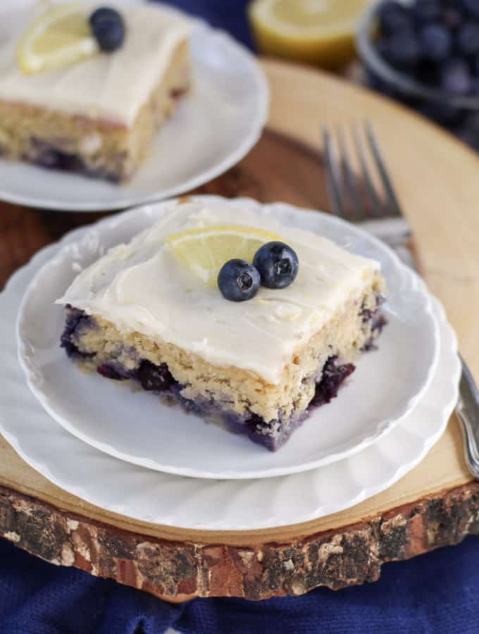 A piece of cake on a plate, with Blueberry