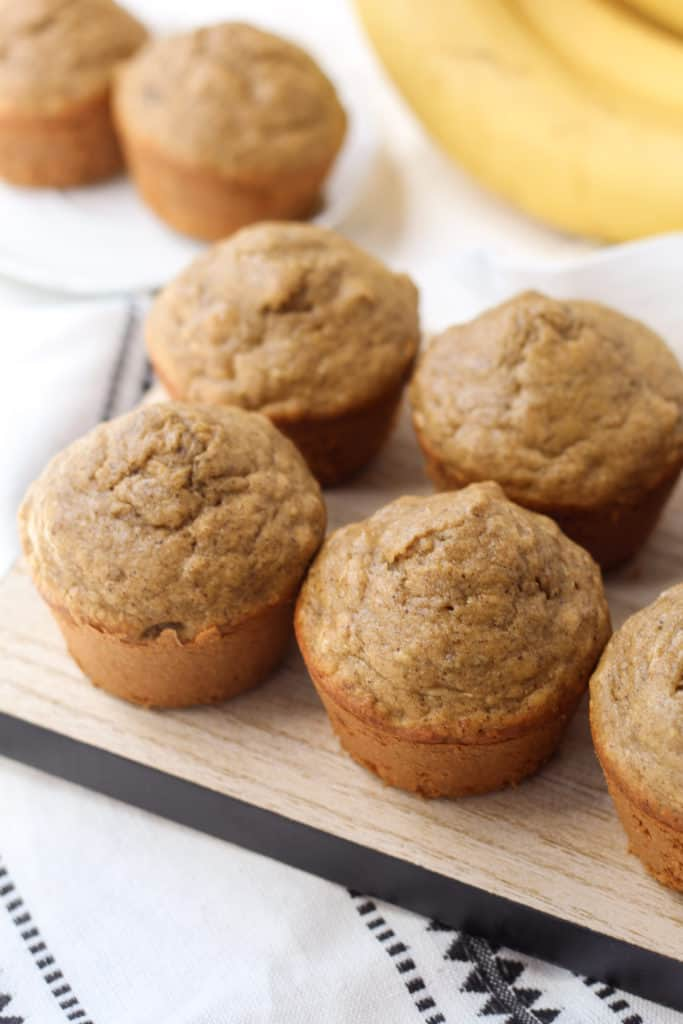 a tray with four banana nut oat muffins