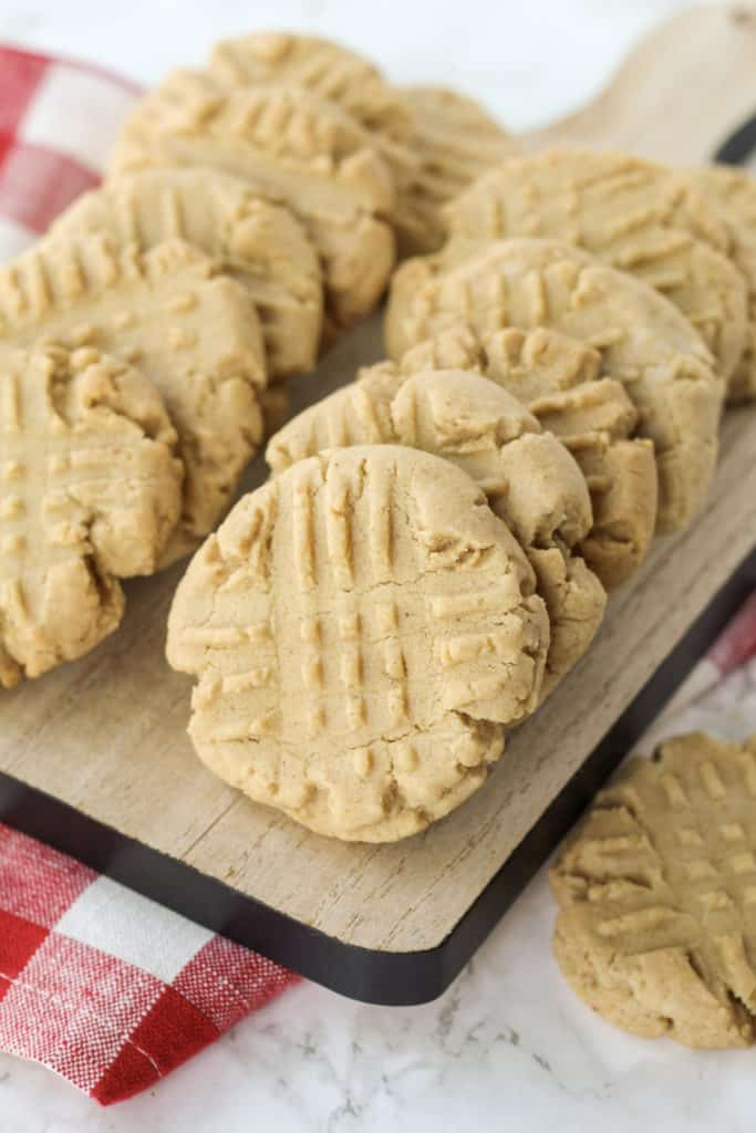 two rows of peanut butter cookies on a tray