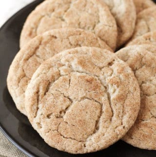A close up of snickerdoodles on a plate