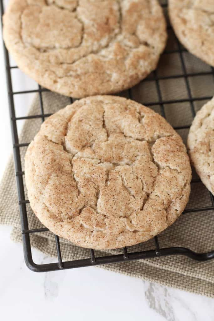 One Snickerdoodle Cookie on a cooling rack