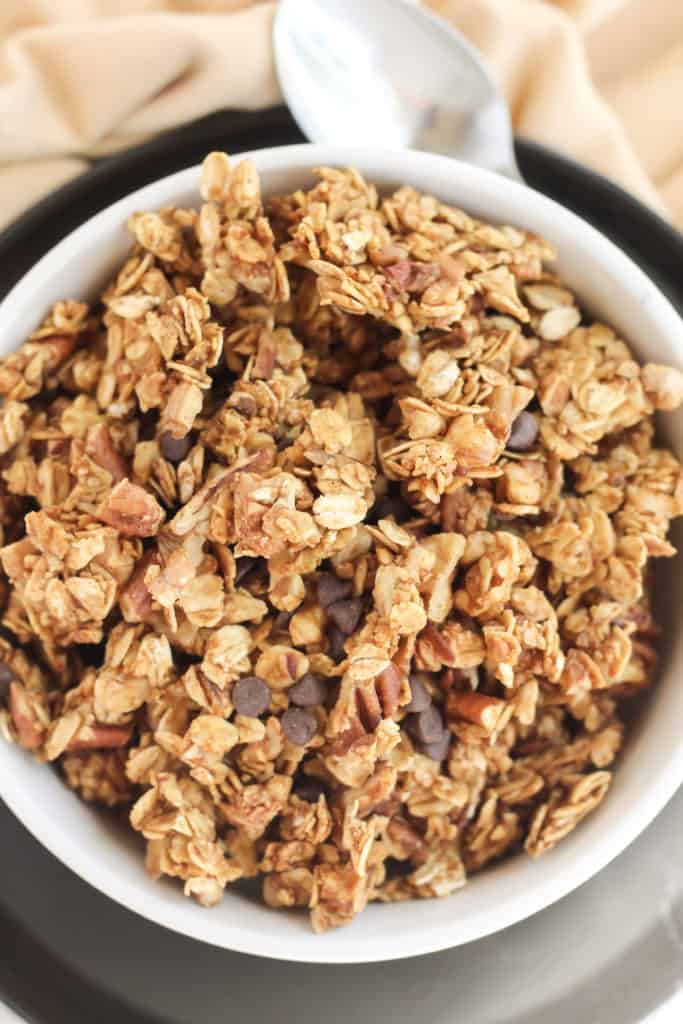 Close up view of Pumpkin Chocolate Chip Granola in a bowl on a plate