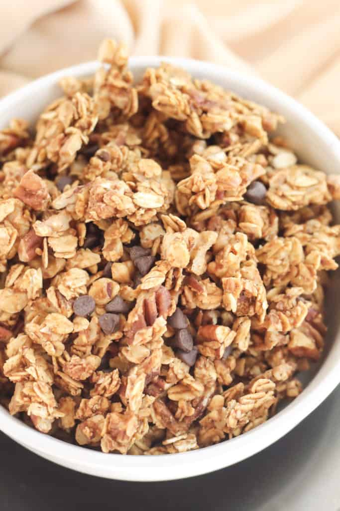 Pumpkin Chocolate Chip Granola in a bowl, on a black plate