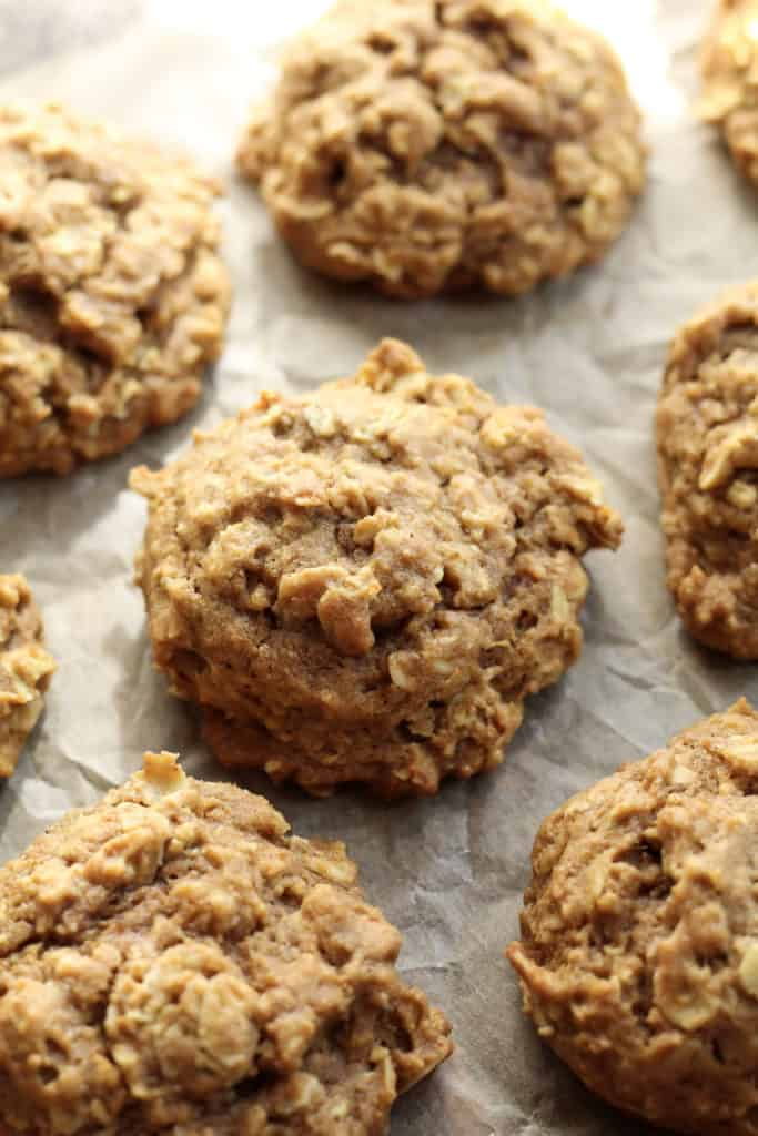 Soft Pumpkin Oatmeal Cookies on a pan with parchment paper underneath