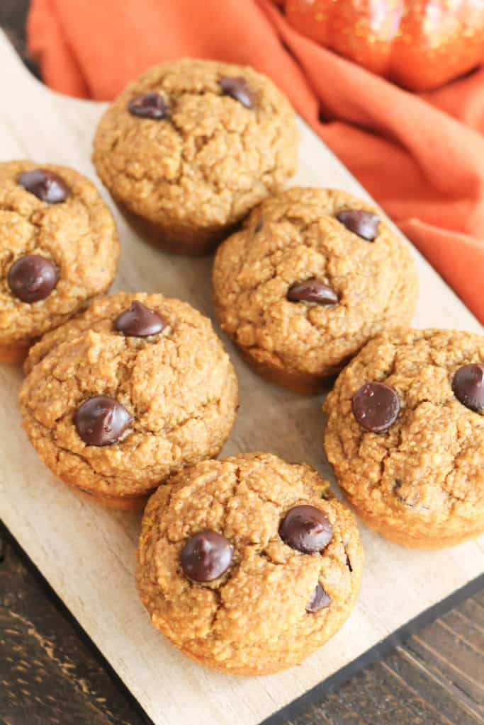 top down view of six Pumpkin Chocolate Chip Oat Muffins on a tray