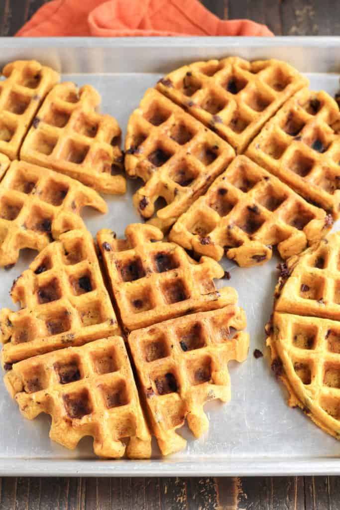 A baking pan with Pumpkin Chocolate Chip Waffles spread across