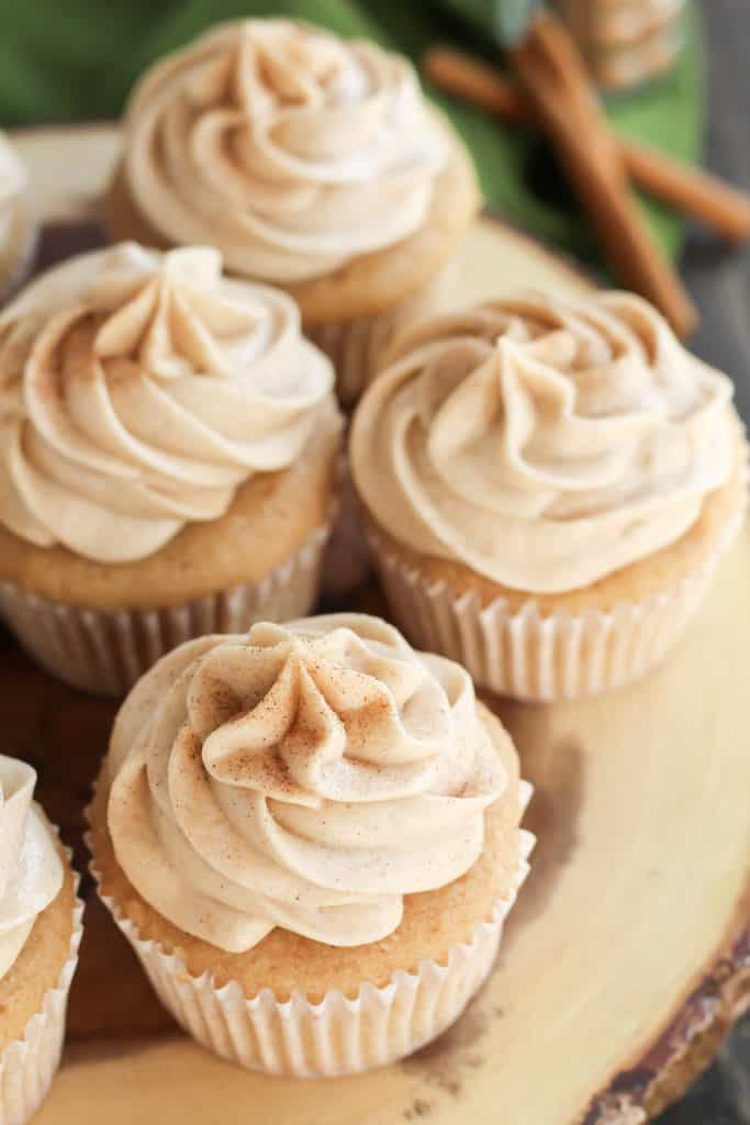 Top down view of Snickerdoodle Cupcakes on a wood tray