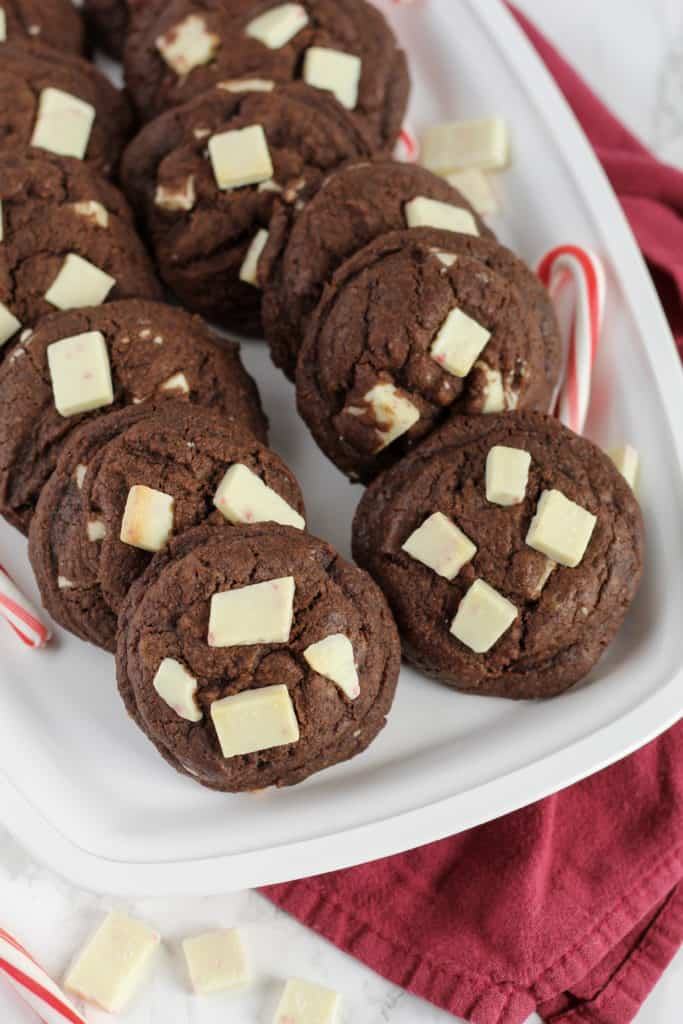 Tray of Chocolate Peppermint Cookies with candy canes around