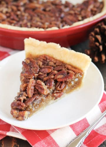 A plate with a slice of pecan pie