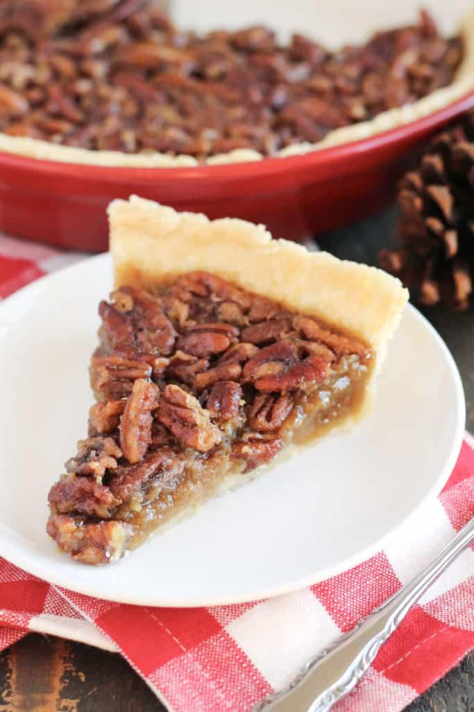 One slice of pecan pie on a plate