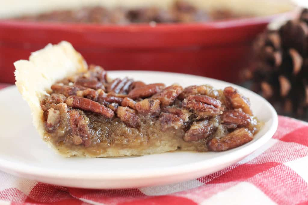 A side view of pecan pie on a plate