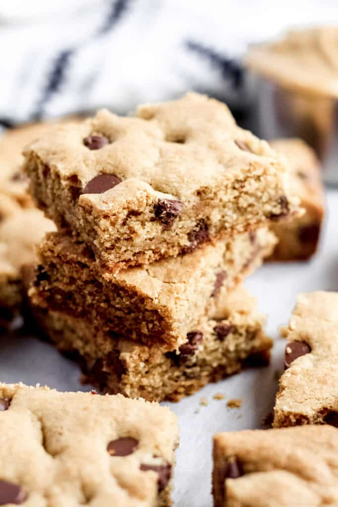 A stack of three Peanut Butter Cookie Bars surrounded by more bars