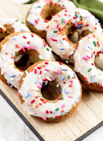 A tray with donuts and sprinkles