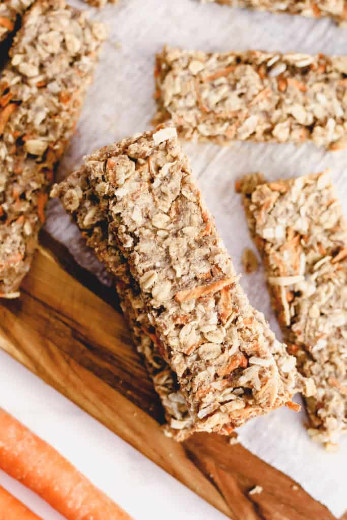 a stack of Carrot Coconut Granola Bars with a few bars scattered around