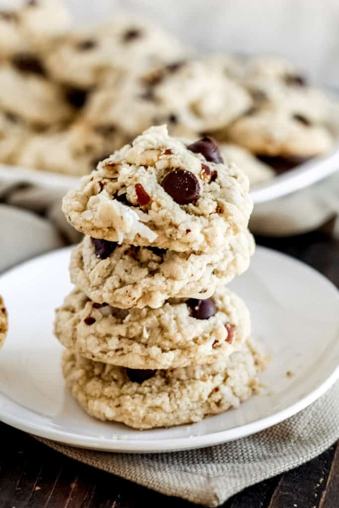 a plate with a stack of 4 almond joy cookies from the side