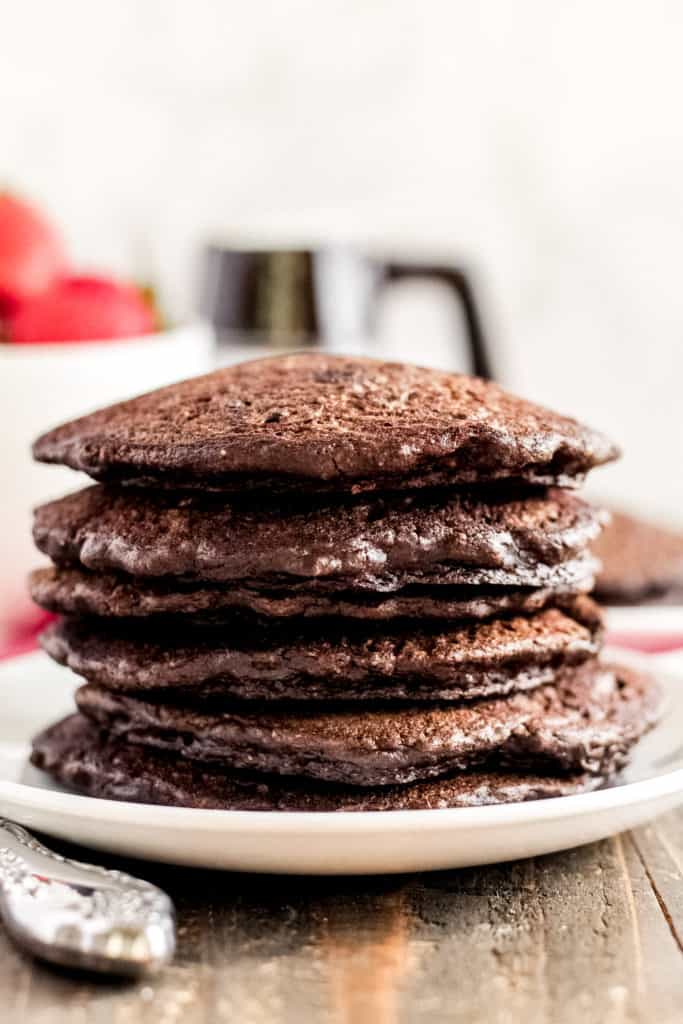 side view of a stack of Chocolate Oat Pancakes on a plate