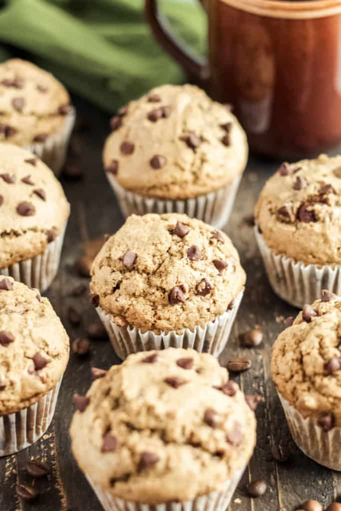 a muffin surrounded by other muffins and coffee beans
