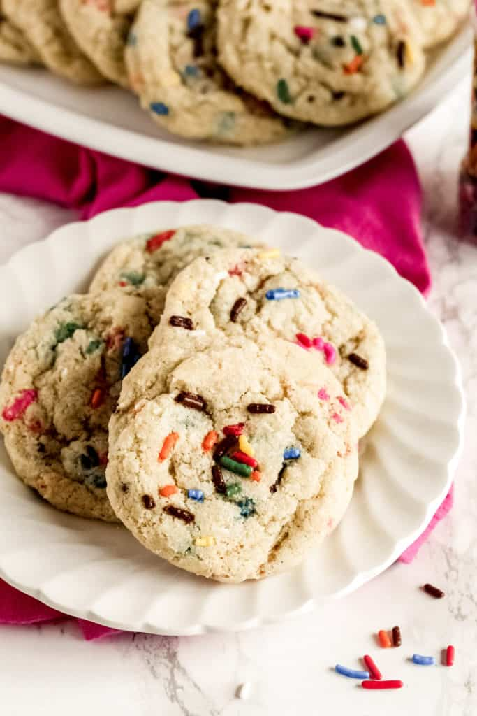 a plate with four funfetti cookies