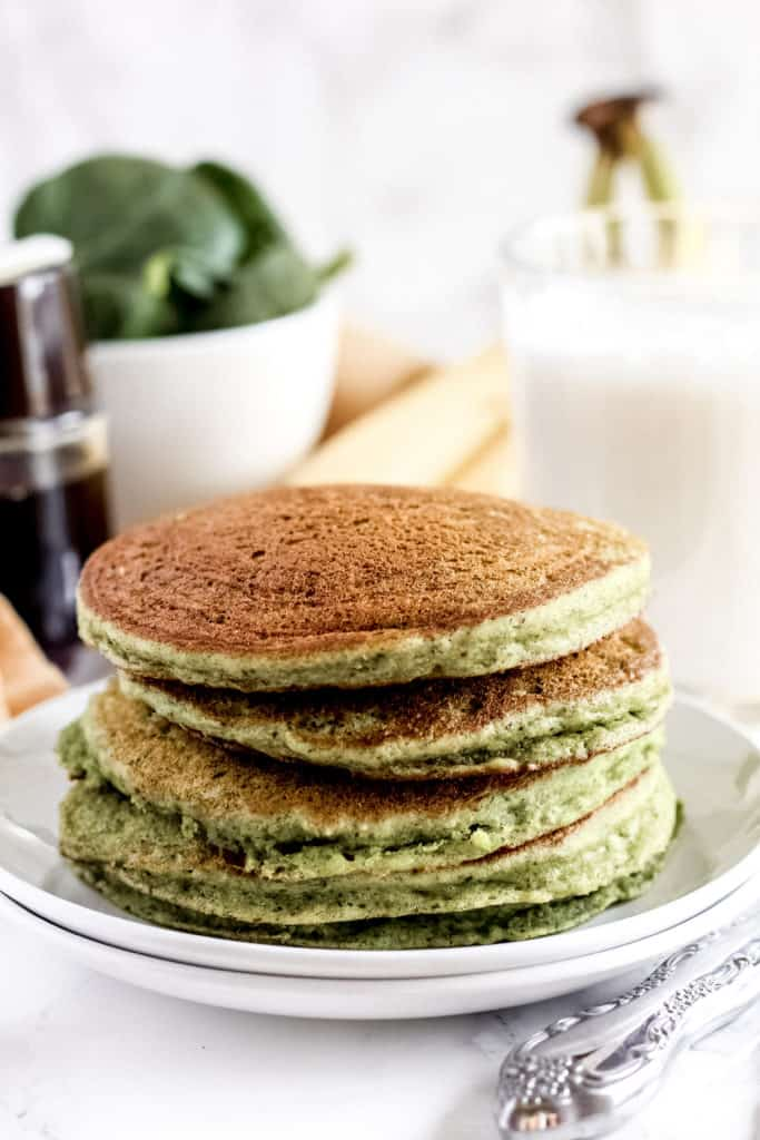 side view of pancakes on a plate