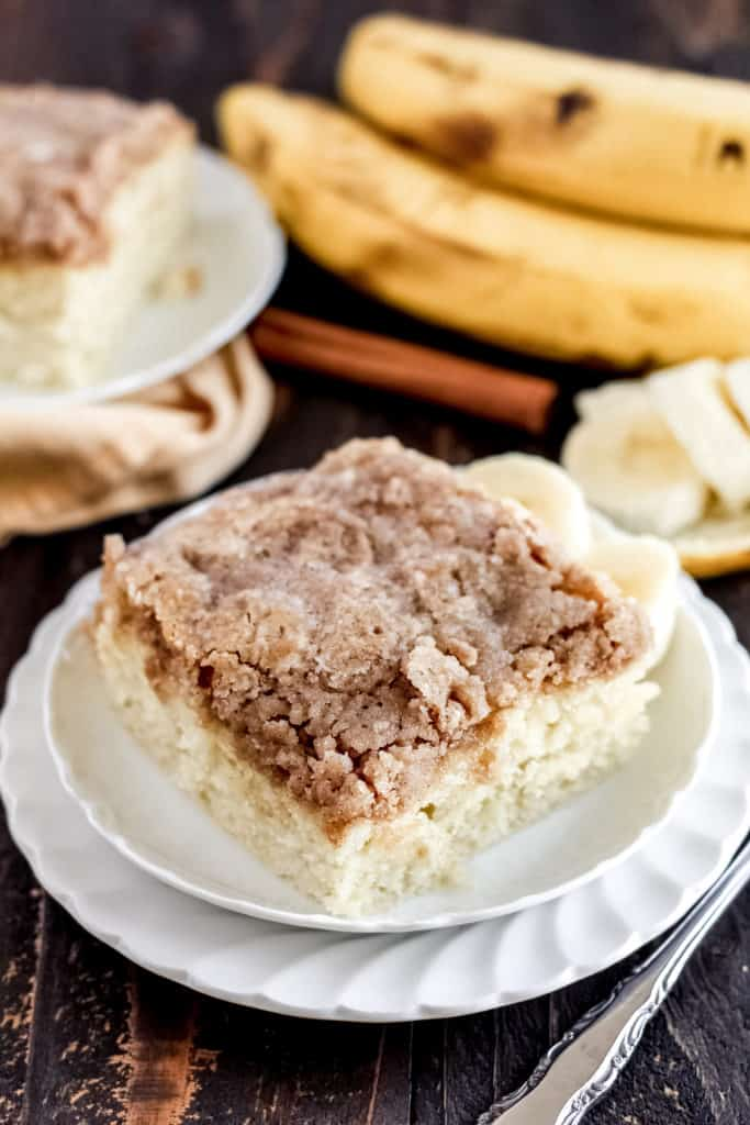 two plates with banana coffee cake on top