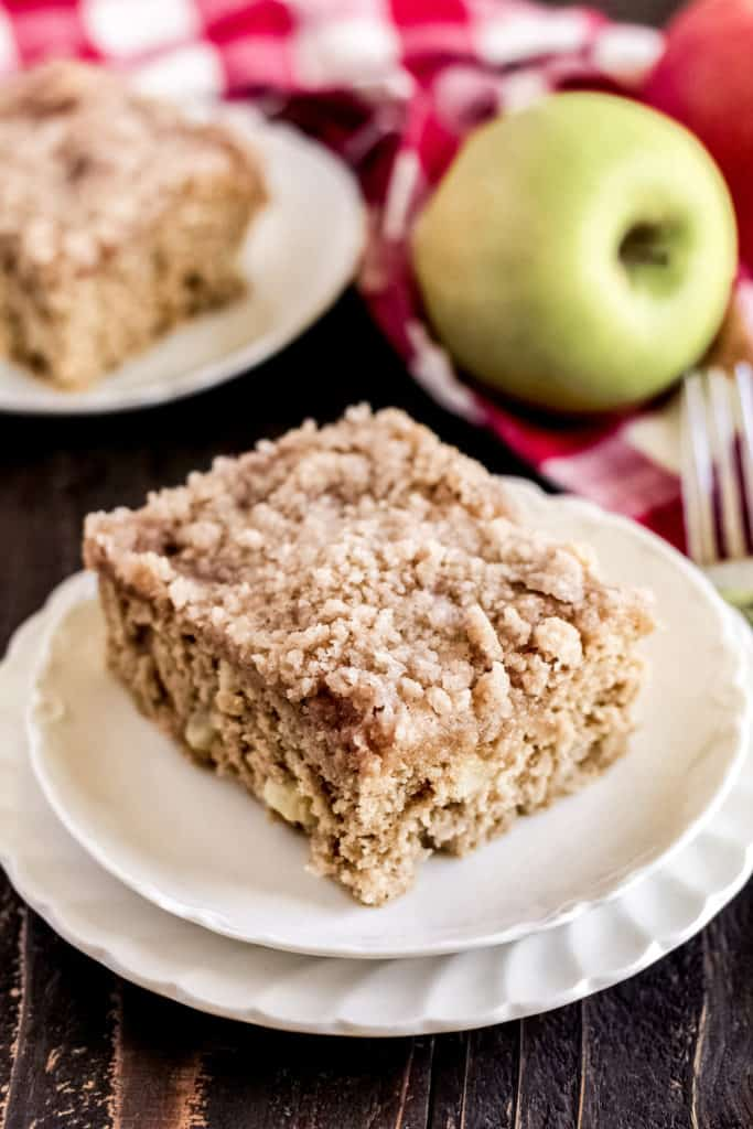 piece of apple cinnamon coffee cake on two plates