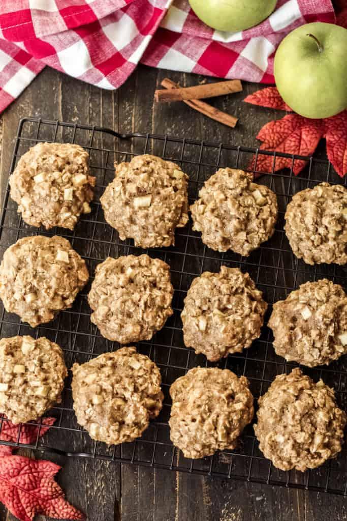Apple cinnamon oatmeal cookies on a cooling rack