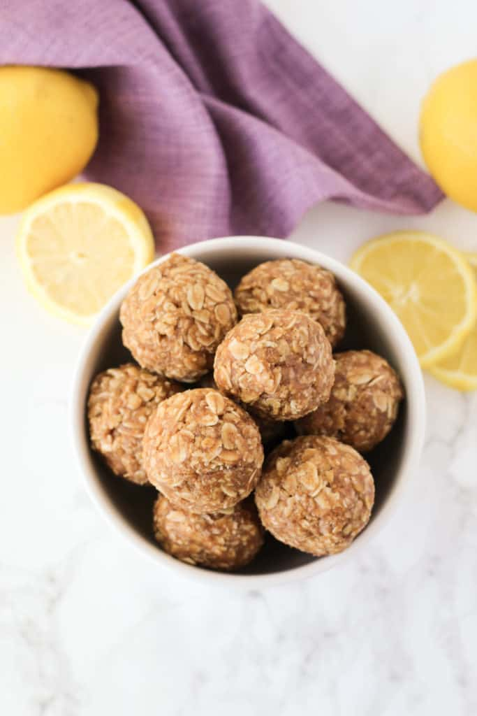 Energy balls in a bowl with lemon slices